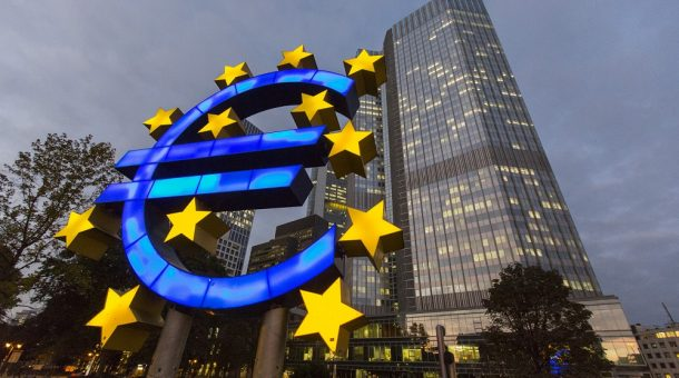 A euro sign sculpture stands illuminated in front of the European Central Bank (ECB) headquarters in Frankfurt, Germany, on Thursday, Oct. 23, 2014. At noon in Frankfurt on Oct. 26, investors will learn which of the currency bloc's 130 biggest banks fell short in the ECB's year-long examination of their asset strength and ability to withstand economic turbulence. Photographer: Martin Leissl/Bloomberg